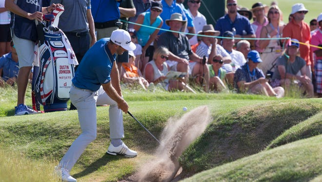 Dustin Johnson hits out of a bunker on the ninth hole during the second round of the U.S. Open Friday at Erin Hills.