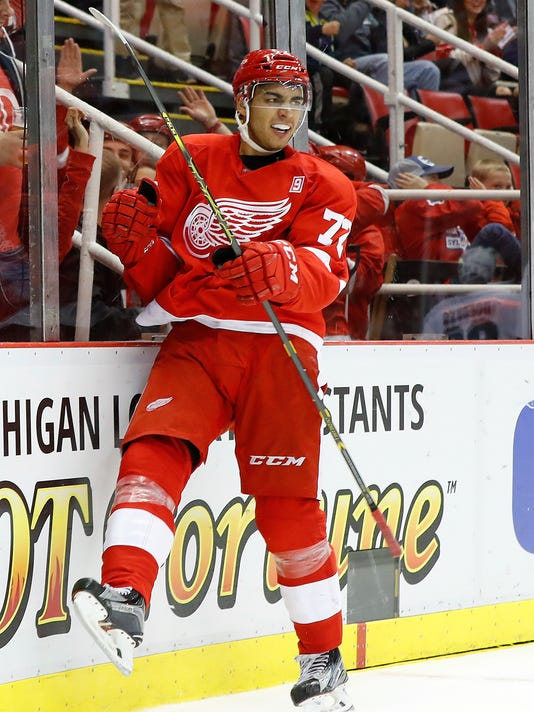 Detroit Red Wings center Andreas Athanasiou (72) celebrates his goal against the San Jose Sharks in the third period of an NHL hockey game in Detroit, Saturday, Oct. 22, 2016. (AP Photo/Paul Sancya)