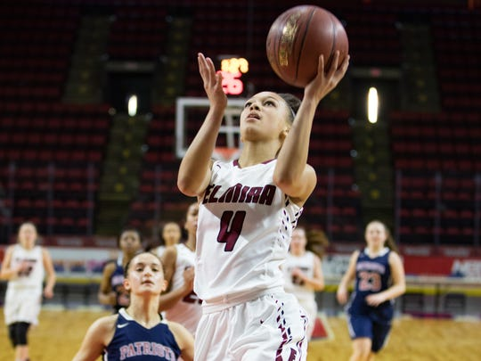 Elmira's Kiara Fisher beats Lexi Gruss of Binghamton to the basket in the Section 4 Class AA girls basketball title game Saturday at Floyd L. Maines Veterans Memorial Arena in Binghamton.