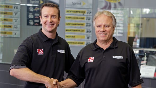 Kurt Busch, left, hopes American fans will support owner Gene Haas, right, and give Formula One another chance.