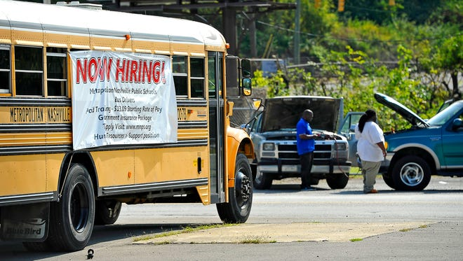 A bus placed at the Tennessee State Fairgrounds announces that Metro Nashville Public Schools is looking for bus drivers.