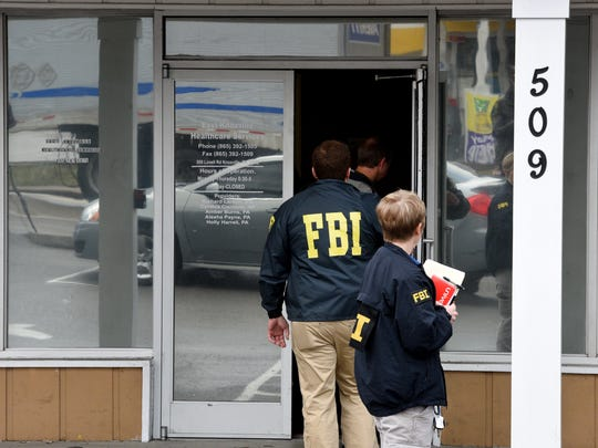 FBI and local law enforcement officers raid a pain clinic March 10, 2015, at East Knoxville Healthcare Services.