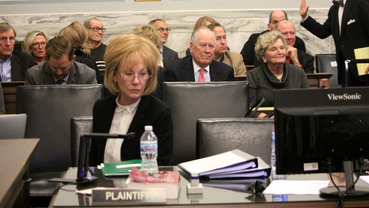 Dianne Rosenberg (front) waits as her lawyers and the