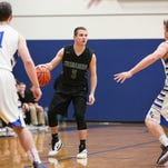 Salem Academy junior Rylan Stamback (3) looks for an open teammate in a game at Blanchet on Thursday, Feb. 4, 2016. Blanchet won 51 to 38.
