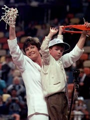 Tennessee head coach Pat Summitt holds up the net with