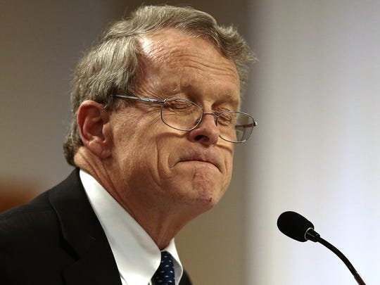 Ohio State Attorney General Mike DeWine hesitates before