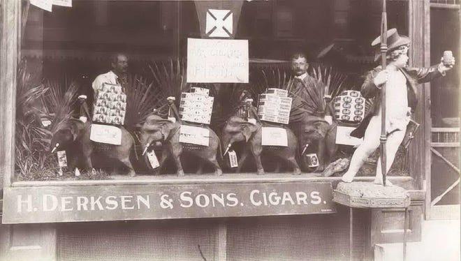 The exterior of the Herman Derksen & Sons Cigar Store, taken between 1895 and 1905.