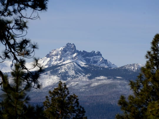 A snow-capped Three Fingered Jack is seen from the highway near Camp Sherman in the Sisters area.