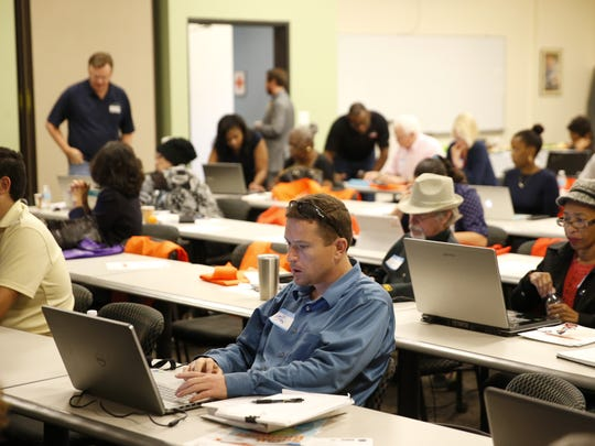 Local business owners, including Ryan McCullion of Bumper Stickers Etc., center, look for help in creating a Google business page presence at the Google Business Town Hall at the American Red Cross Capitol Area Chapter on Monday, Nov. 30, 2015.