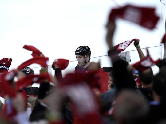 Fans cheer for New Jersey Devils left wing Taylor Hall (9) after his goal in the second period against the Tampa Bay Lightning in Game 3 of Round 1 of the Stanley Cup Playoffs at the Prudential Center in Newark, NJ on Monday, April 16, 2018.
