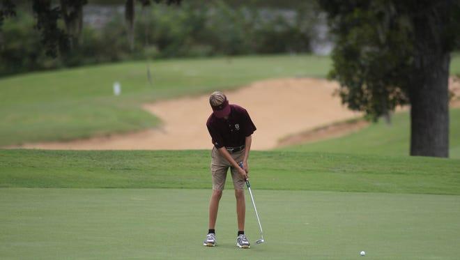 Florida High's Justus Jones plays during the City Championship at Hilaman Golf Course.