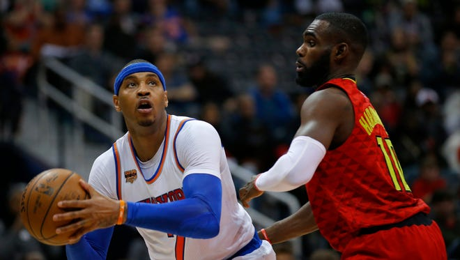 New York Knicks forward Carmelo Anthony (7) looks to shoot around Atlanta Hawks guard Tim Hardaway Jr. (10) in the first overtime of an NBA basketball game on Sunday, Jan. 29, 2017, in Atlanta. The Hawks won the game in the fourth overtime 142-139.