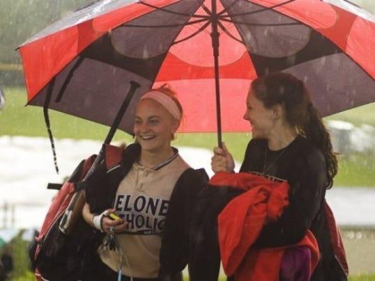 Delone Catholic's Deanna Laughman, left, and Madison Shockey of Susquehannock walk off the field after a rain postponement last season. (GAMETIMEPA.COM -- FILE)