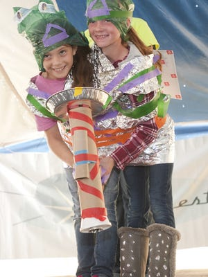Mackhenna Lang, left, and Laurin Hamann, both 9, take the first place of the Costume Contest at the Sputnikfest in 2015. There were 15 contestants in this category.