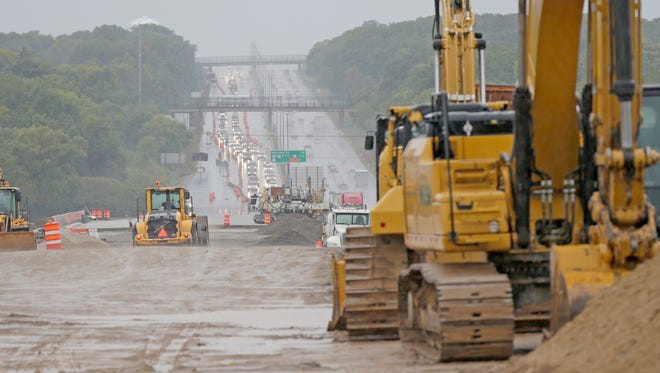 Crews work on rebuilding the Zoo Interchange: The Legislature is debating how best to fund highway projects in Wisconsin, including whether to rebuild I-94 from the Zoo Interchange to downtown Milwaukee.