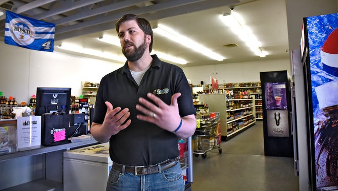 Sauk Rapids Municipal Liquor Store manager Tom Boulton talks Thrusday, April 14, about details of the upcoming $120,000 renovation of the store. New interior lighting, flooring, paint and automated doors are part of the renovation plan.