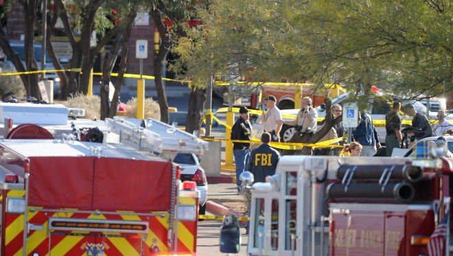 Records released by the FBI provide insights and details -- but no startling new revelations -- about the investigation into Rep. Gabrielle Giffords' shooting along with 18 others in 2011. Here, law-enforcement officers quarantine the shopping center where the shootings took place  near Tucson.