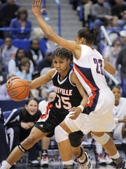 Louisville's Angel McCoughtry, left, drives past Connecticut's Maya Moore during the first half of the Big East tournament championship in 2008.