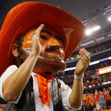 Oklahoma State mascot Pistol Pete applauds/gazes into your soul.