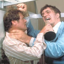 """Richard Kiel, right, as Jaws and Roger Moore, as James Bond, fighting in the 1977 film, """"The Spy Who Loved Me."""""""
