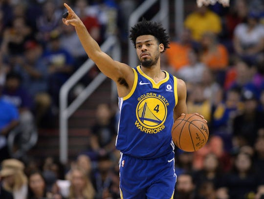 Golden State Warriors guard Quinn Cook gestures as