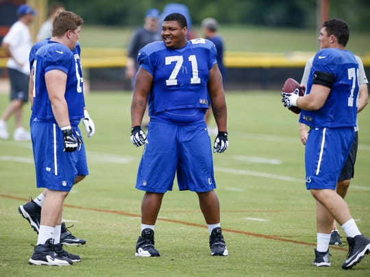 Indianapolis Colts offensive lineman Denzelle Good (71) talks with fellow Colts linemen before practice at Anderson University on Aug. 9, 2016.