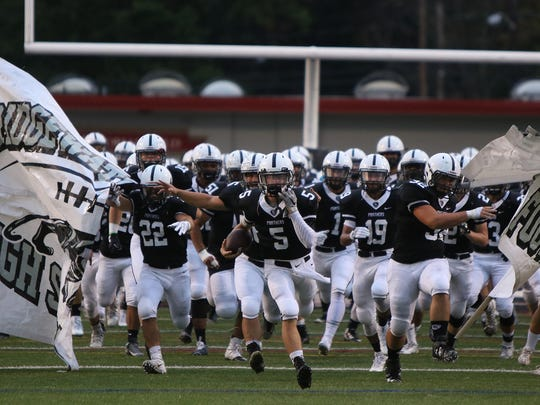 The Bridgewater-Raritan High School football team takes the field for a game last season.