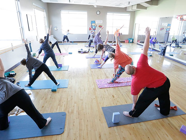 People participate in a yoga class at the Fond du Lac