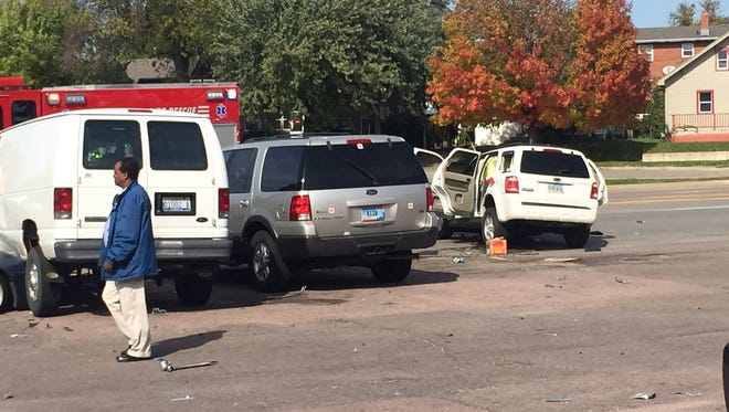 Witnesses say the driver of the white Ford Escape plowed through five cars before rolling and fleeing the scene near 12th and Grange.