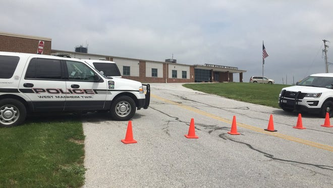 The West Manheim Township building and police department is closed while police work to dispose of explosive devices dropped off by a resident looking to dispose of them.