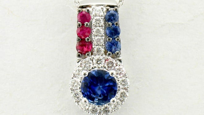 Do you have the winning number for the diamond, ruby and sapphire pendant?