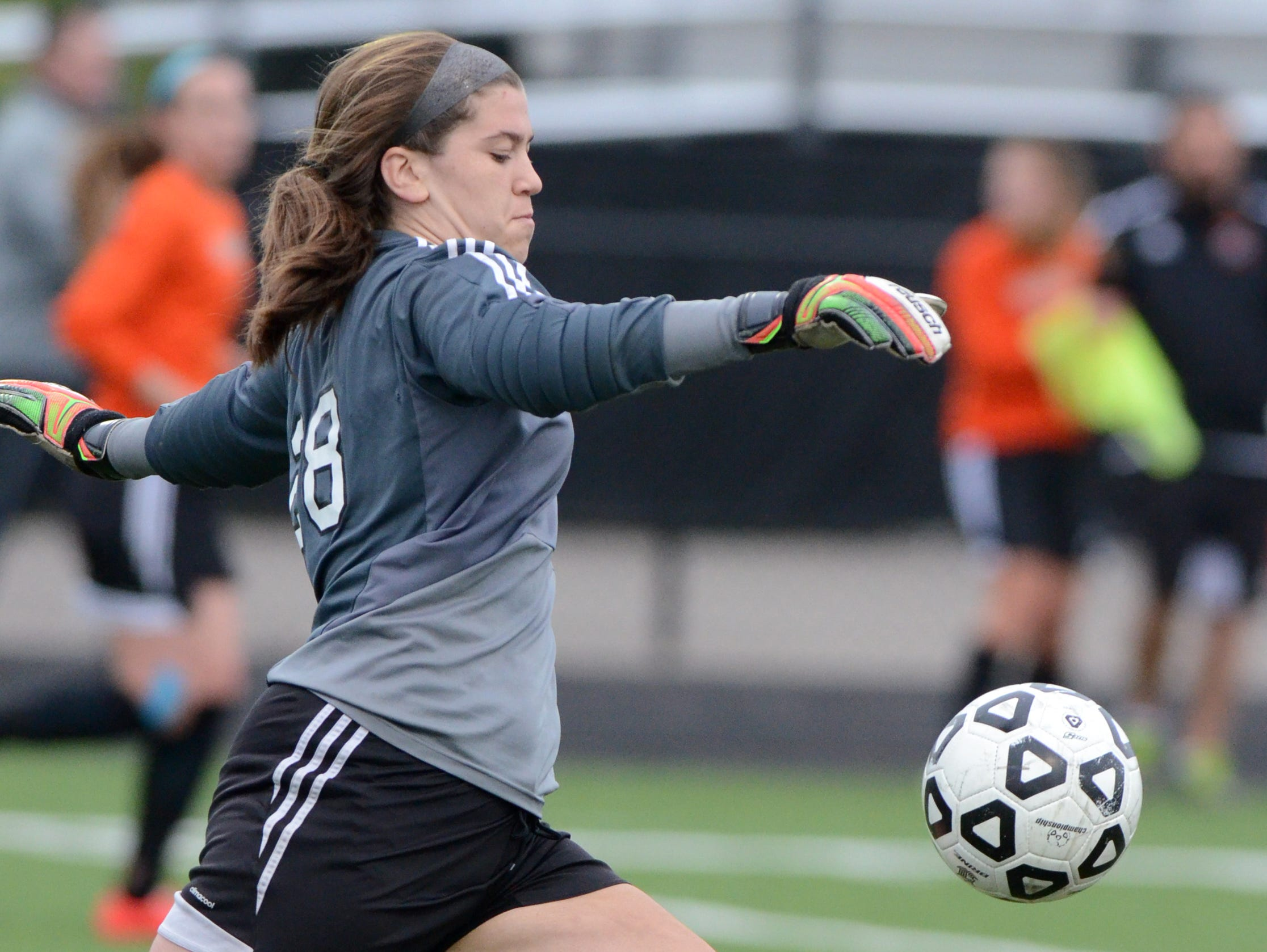 Northville senior goalkeeper Emily Maresh punts the ball during first-half action in the KLAA Association championship match against Brighton.
