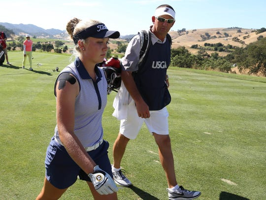 Erica Shepherd's caddie and coach Brent Nicoson, who