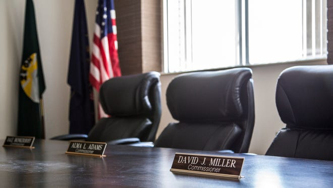 Former county commissioner David Miller's name plate sits in front of his chair inside the Iron County Courthouse in Parowan, Friday, Mar. 25, 2016.