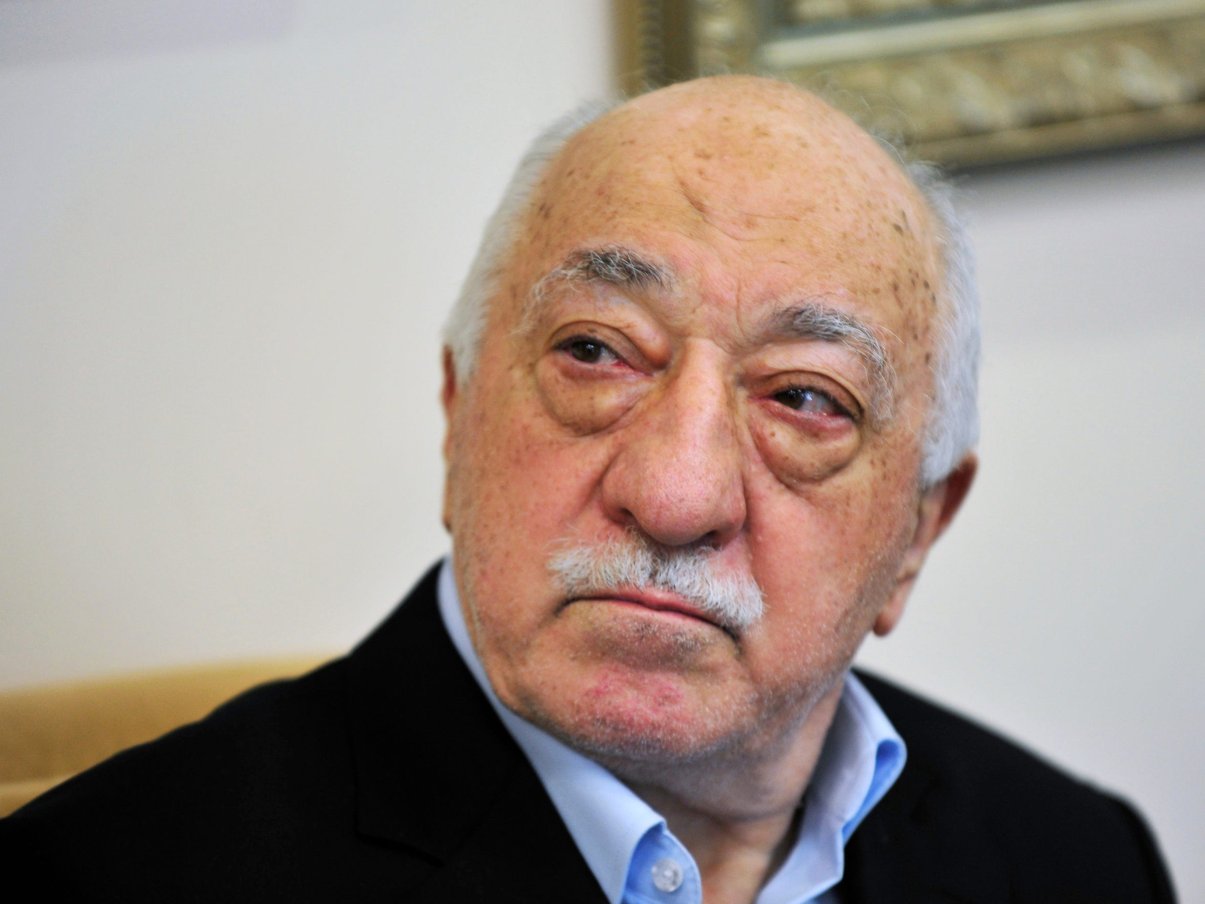 In this July 2016 photo, Islamic cleric Fethullah Gulen speaks to members of the media at his compound in Saylorsburg, Pa.