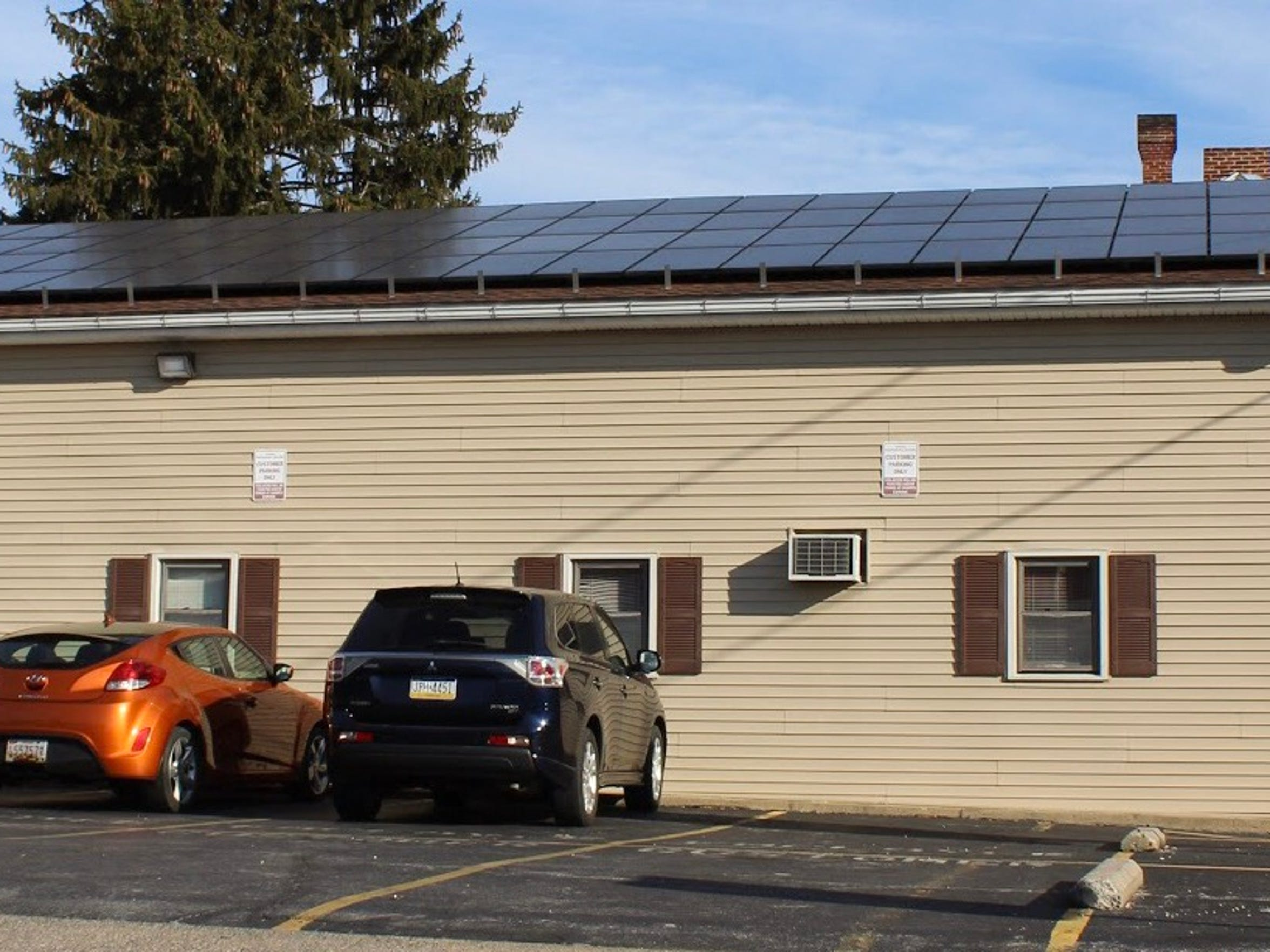 Business owner Mike Cermak installed 96 solar panels on his computer business' roof on South Potomac Street in Waynesboro. Cermak also installed solar panels on the roof of his Chambersburg home.