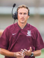 Vermilion Catholic coach Brady Thomas coaches from