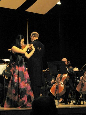 First place winner violinist Chie Xu. Standing next to her is Music Director David Harman.