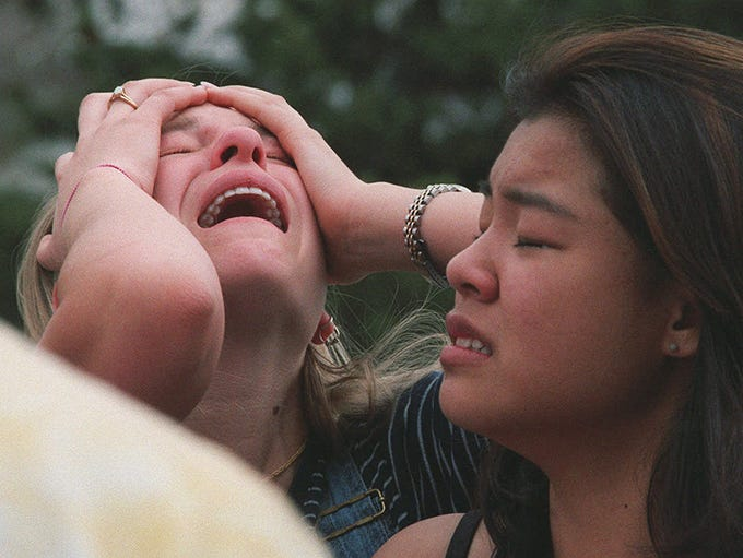 **FILE**Students react at a triage area near Columbine