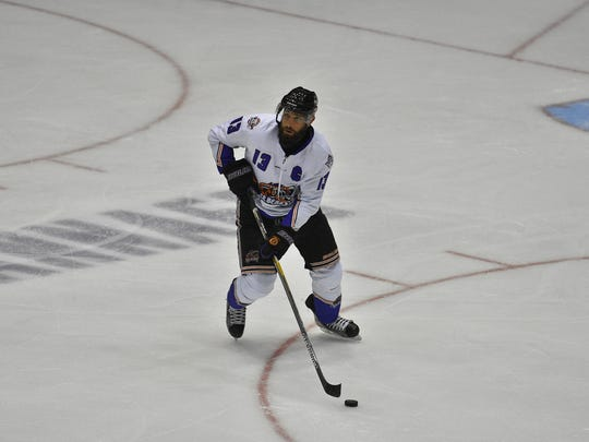 Knoxville defenseman Jason Price skates during Saturday's game against Mississippi at the Civic Coliseum.