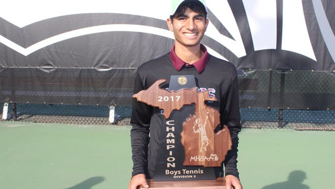 Dinakar Talluri was part of Okemos' title-winning No. 1 doubles tandem. His contributions also helped the Chiefs capture the Division 2 team title on Saturday at Kalamazoo College.