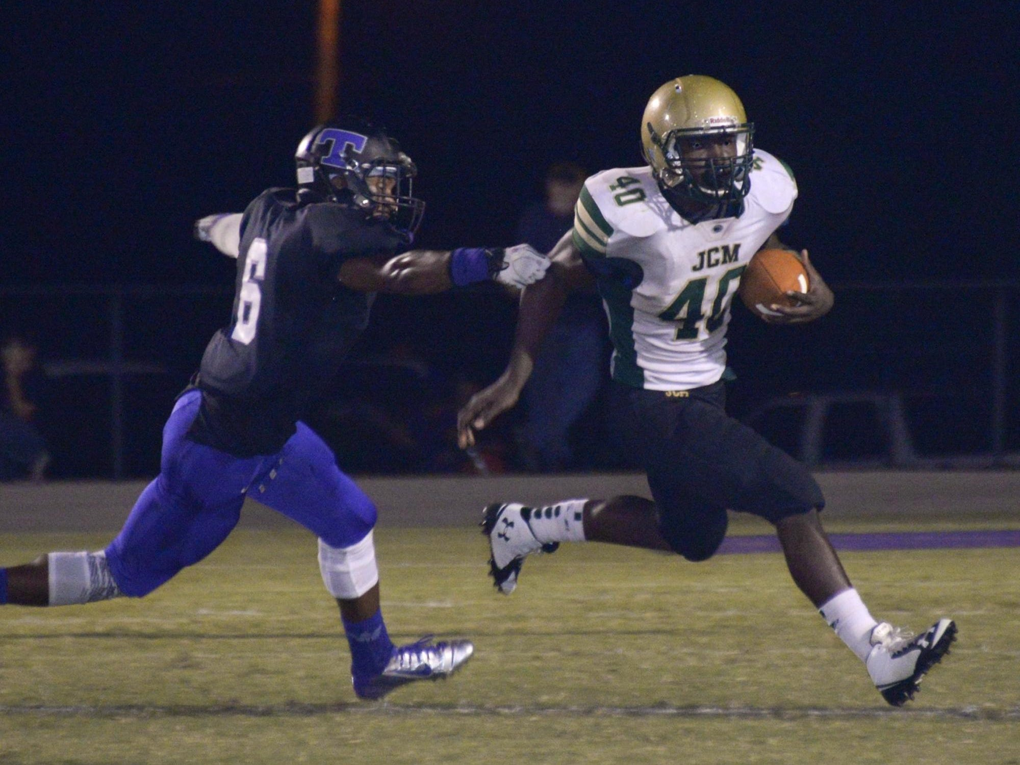 JCM running back Trayvone French gets away from a defender in a loss to TCA last year.