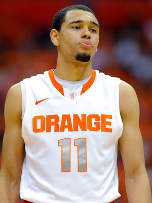 Syracuse Orange guard Tyler Ennis (11) looks on against the Cornell Big Red during the second half at Carrier Dome.  Syracuse defeated Cornell 82-60.