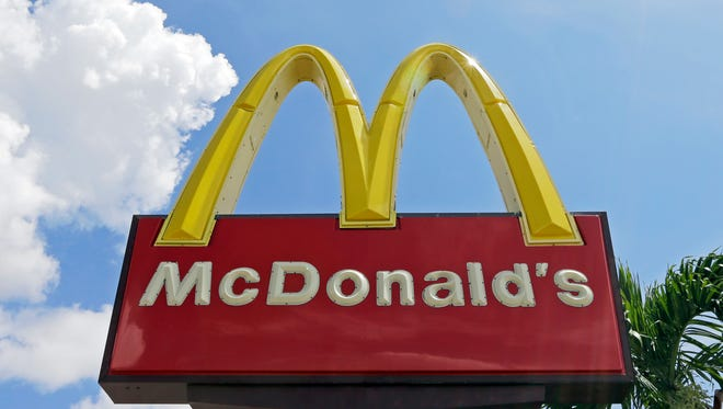 A McDonald's sign in Miami is shown June 28. The company is having mixed financial results.