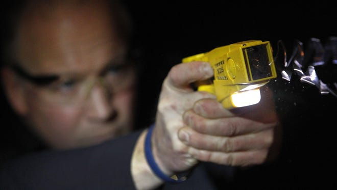 A police officer in Wisconsin deploys a Taser International X26 in 2012. This past week, York County approved the purchase of 15 tasers for use by the county Department of Probation Services.