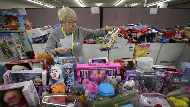 Salvation Army volunteer Sylvia King of Appleton sorts through girls toys Monday, December 18, 2017, at Fox Valley Christian Fellowship Church in Kimberly, Wisc. Volunteers and workers are preparing for The Salvation Army-Fox Cities' annual Christmas Toy Shop distribution for families in need. Each child will receive a variety of toys and families will receive gifts from members of the public that sponsored them as part of the Adopt-a-Family program. Dan Powers/USA TODAY NETWORK-Wisconsin