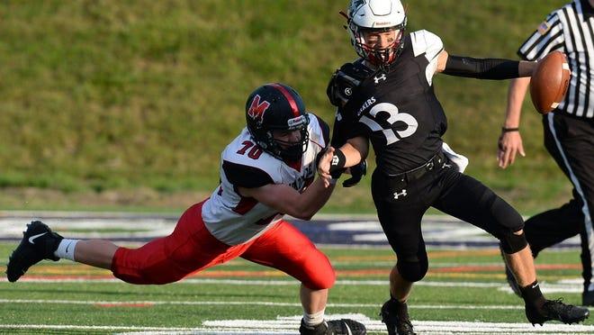 Mercyhurst Prep quarterback Matt Luce tries to break away from a Meadville player last season.