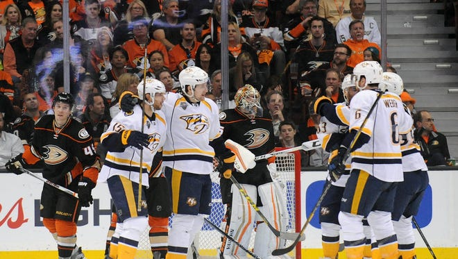 Nashville Predators celebrate the goal scored by center Craig Smith (15) against Anaheim Ducks during the second period in game two of the first round of the 2016 Stanley Cup Playoffs at Honda Center.