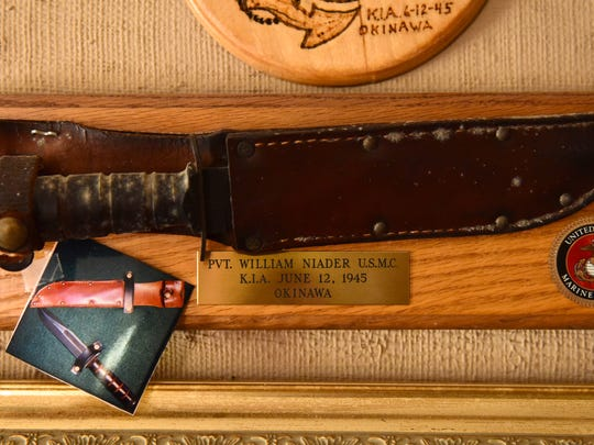 The battle knife of William Naider who died in Okinawa while serving in the Marines during World War II hangs in the officer of his brother, Frank, of Wayne. Frank Naider wanted to find out more about his brother's death and ended up creating a network of WWII era servicemen.