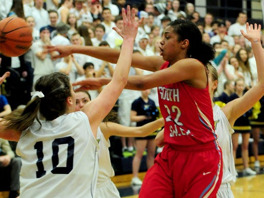 South Salem guard Evina Westbrook makes a pass under pressure against West Albany during a Greater Valley Conference game last month in Albany.